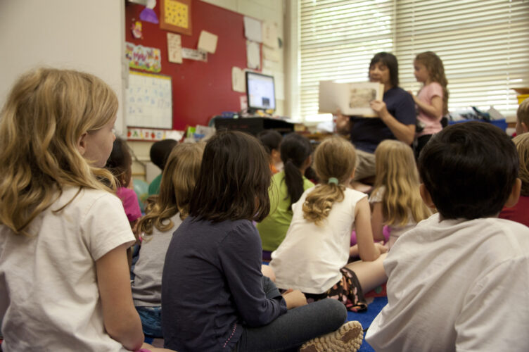teacher reading to children in classroom