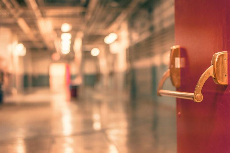 open door to empty hallway