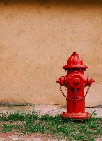 fire-hydrant in front of orange wall
