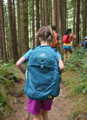 children hiking through forest